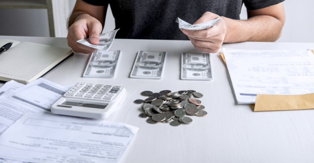 zero-based budget | man budgeting his dollars and coins